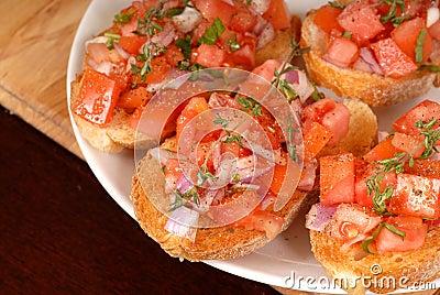 Tomato and onion bruschetta wi
