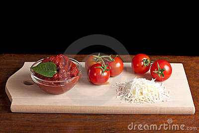 Tomato paste, cheese and some tomatoes