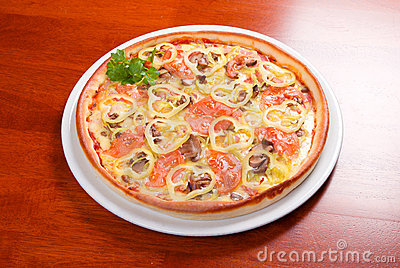 Tomato pizza on plate.