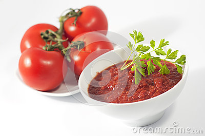 Tomato sauce bowl and plate with red tomatoes