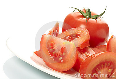 Tomato and slices on plate