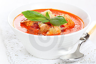 Tomato soup with basil leaves