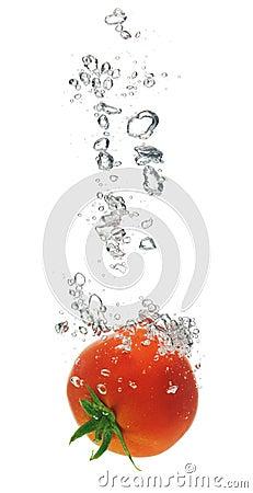 Tomato splashing in water