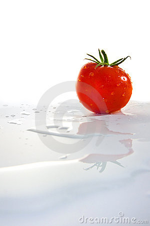 Tomato with water reflection