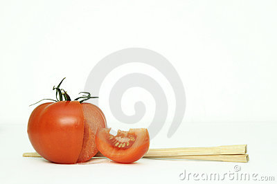 Tomatoe and chopsticks.