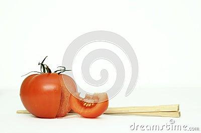 Tomatoe and chopsticks.