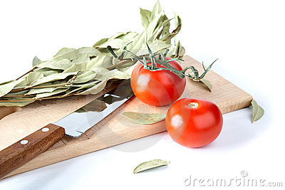 Tomatoes and bay leaf branches