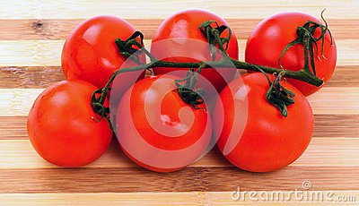 Tomatoes on a cutting board isolated on white background