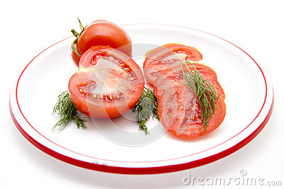 Tomatoes with dill on plate