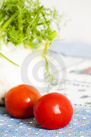Tomatoes and fennel on blue tablecloth