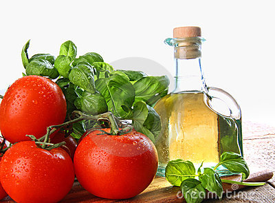 Tomatoes With Fresh Basil And Olive Oil Royalty Free Stock Image - Image: 12833776