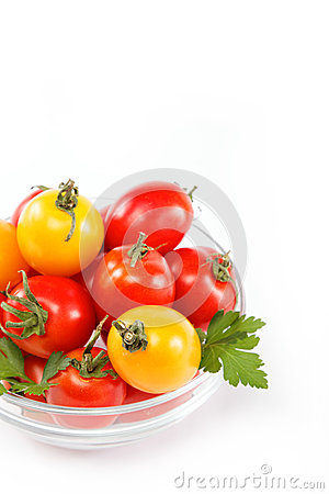 Tomatoes in a glass isolated on a white.