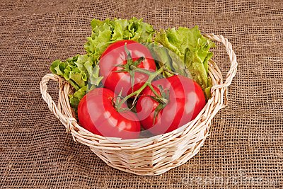 Tomatoes and lettuce in basket