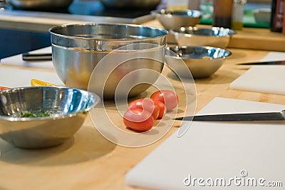 Tomatoes and mixing bowls
