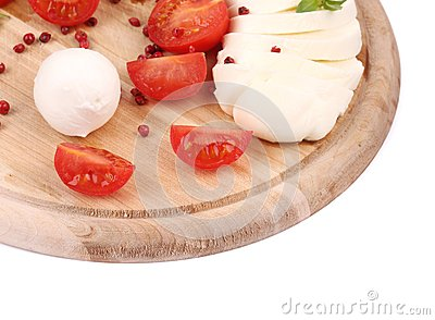 Tomatoes and mozzarella balls.
