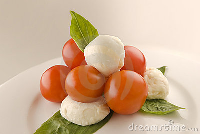 Tomatoes and mozzarella with fresh basil