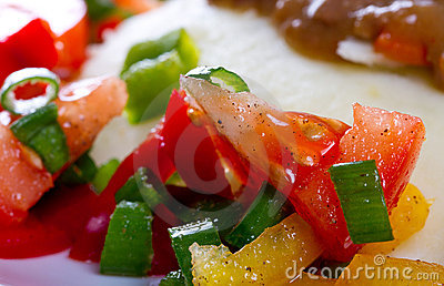 Tomatoes an pepper salad to the dinner