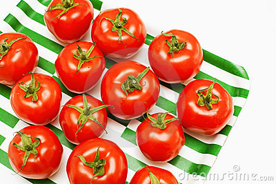 Tomatoes on striped tray