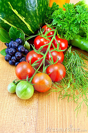 Tomatoes and vegetables on the board