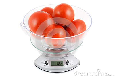 Tomatoes are weighed in the balance