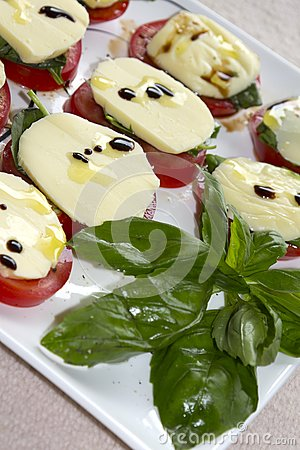 Tomatos, cheese and basil with olive oil.