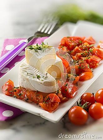 Tomino cheese with pachino tomatoes