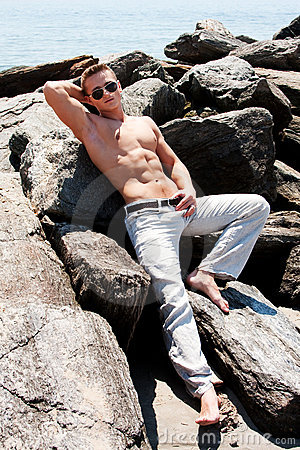 Toned man on rocks