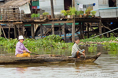 Tonle Sap Villagers on a Boat Editorial Stock Photo
