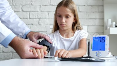 Tonometer Measuring Blood Pressure, Sick Child, Doctor Consulting Kids stock footage