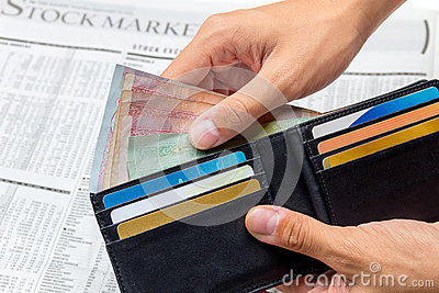 Took the money out of pocket over stock market newspaper