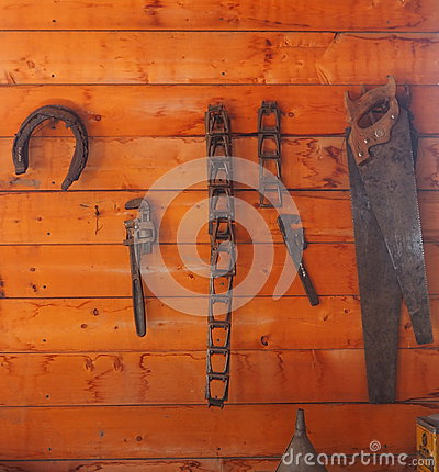 Tools And Horseshoe Hanging On Wall Stock Photo Image