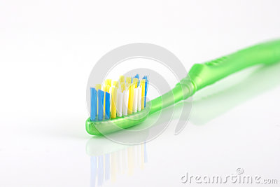 Tooth-brush with green handle