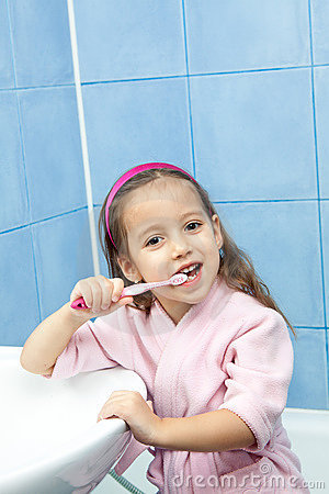 Tooth washing - little girl in bathroom