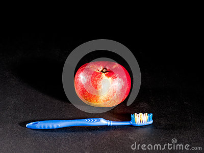 Toothbrush and apple