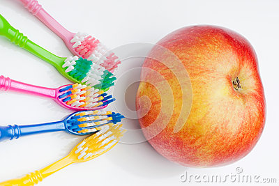 Toothbrushes and apple