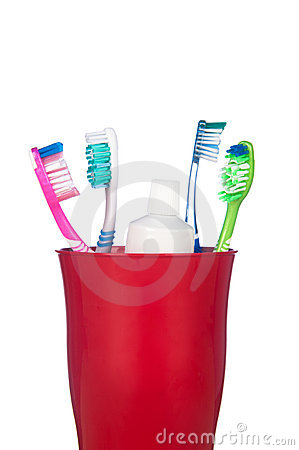 Stock Image: Toothbrushes in a cup