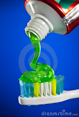Free Toothpaste Being Squeezed Onto A Toothbrush Royalty Free Stock Images - 17968759