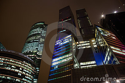 Top floors of modern office building at night