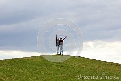 Together / on top of green hill