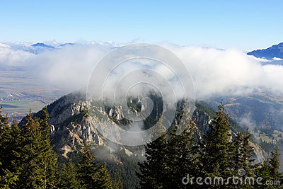 On top of the mountain and above the clouds