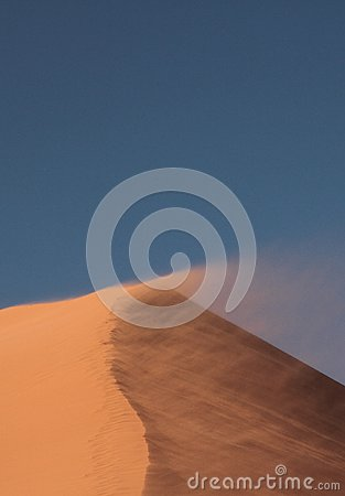 Free Top Of The Dune 45 In Which The Wind Lifts The Sand Stock Photos - 104710773