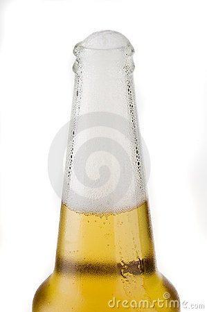 Top part of beer bottle with froth