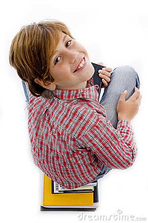 Top view of boy with pile of books