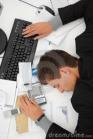 Top view of a business man sleeping on desk