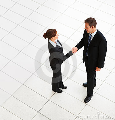 Top view of business people hands shake