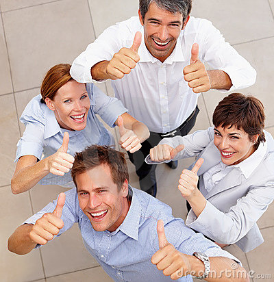 Top view of a business team showing a success sign