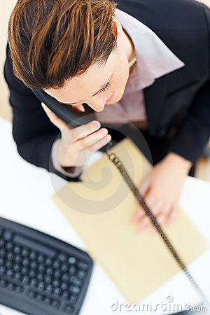 Top view of a business woman using the phone