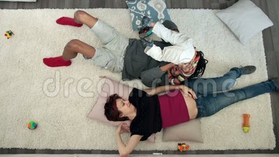Top view of cheerful family with son having fun stock video