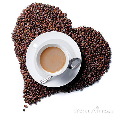 Top view of coffee cup with heart shaped beans