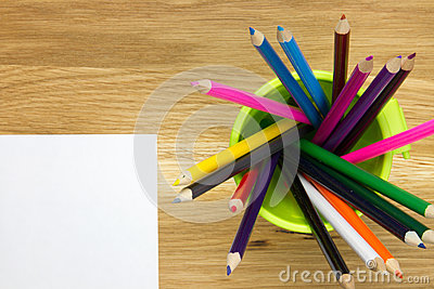 Top-view of empty sheet of paper and container filled with color